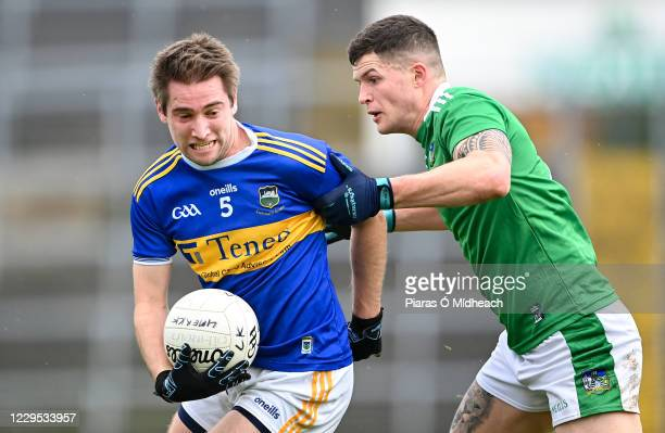 Limerick , Ireland - 7 November 2020; Bill Maher of Tipperary in action against Iain Corbett of Limerick during the Munster GAA Football Senior...