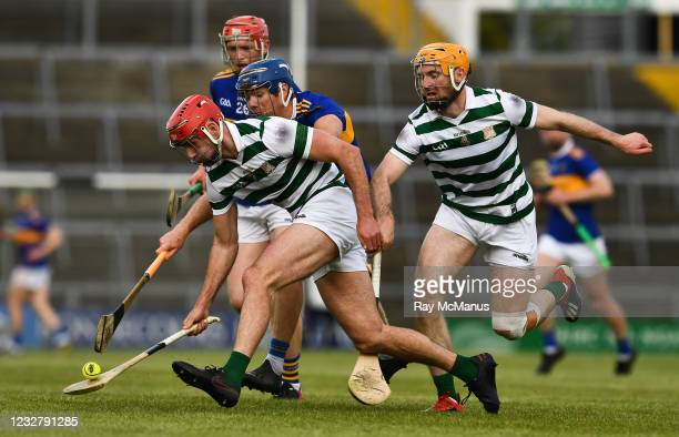Limerick , Ireland - 8 May 2021; Barry Nash of Limerick, supported by team-mate Richie English lifts the sliothar ahead of Tipperary players Jason...