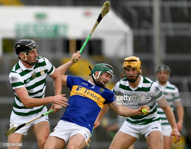 Limerick , Ireland - 8 May 2021; Cathal Barrett of Tipperary prepares to clear under pressure from Conor Boylan, left, and Tom Morrisey during the...