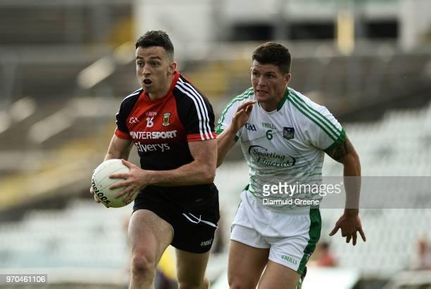 Limerick Ireland 9 June 2018 Evan Regan of Mayo in action against Iain Corbett of Limerick during the GAA Football AllIreland Senior Championship...