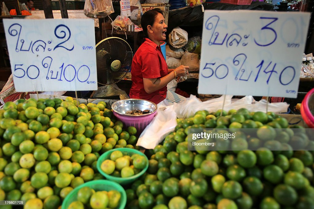 Limes are displayed for sale as a vendor calls for clients at the Klong Thoei market in Bangkok, Thailand, on Sunday, Aug. 18, 2013. Thai economic growth slowed for a second quarter as exports cooled and local demand weakened, with rising household debt restricting the scope for monetary easing. Photographer: Dario Pignatelli/Bloomberg via Getty Images