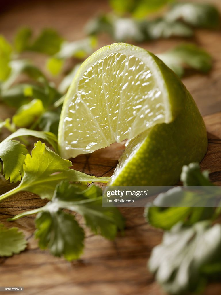 Limes with Fresh Cilantro : Stock Photo