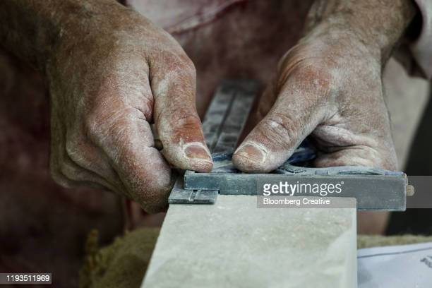 limestone and human hands - manual worker stock pictures, royalty-free photos & images