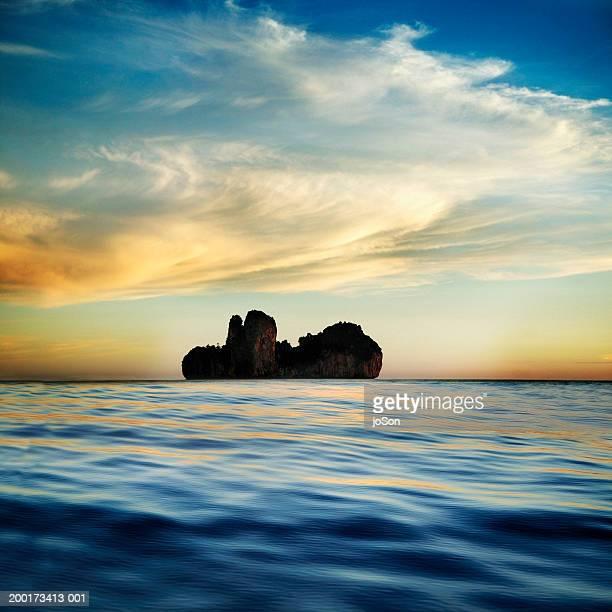 Limestone island in bay, dusk