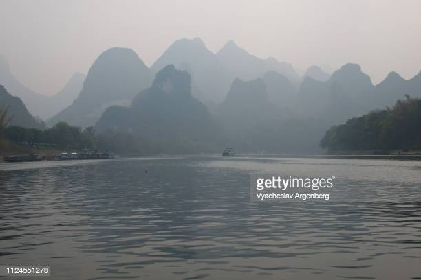 limestone karst scenery on li river near guilin, china - argenberg stock pictures, royalty-free photos & images