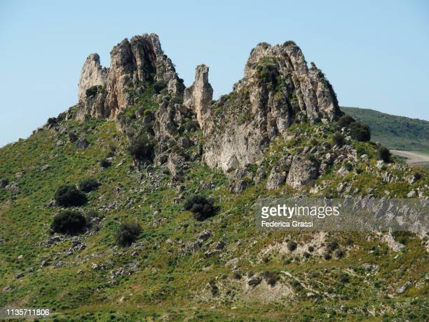 limestone outcrop near riesi in sicily - province of caltanissetta stock photos and pictures