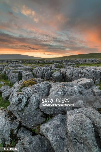 limestone pavement at sunset, ingleton, yorkshire dales, yorkshire, england, united kingdom, europe - limestone pavement stock pictures, royalty-free photos & images