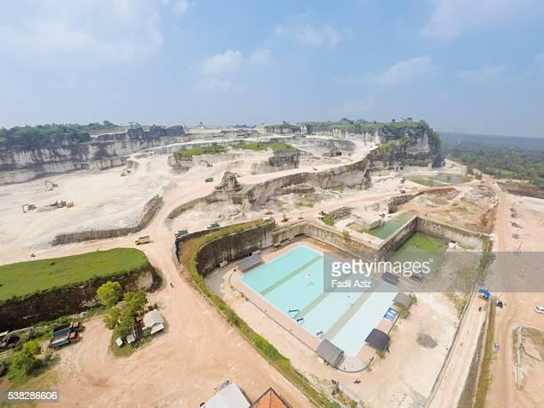 limestone quarry and a swimming pool, aerial view - トラバーチン ストックフォトと画像
