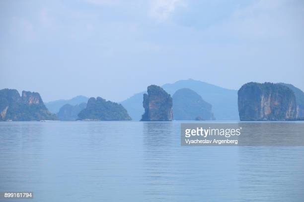 Limestone rocks of Phang Nga bay as seen from Koh Yao Noi island, Thailand
