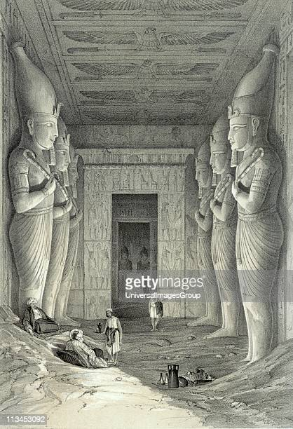 Limestone statues of Ramses II in main temple at Abu Simbel Each holds crook and flail symbols of kingship Lithograph after Jules Goury French...