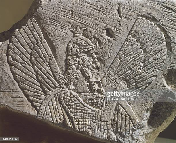 Limestone stele depicting a good winged genius frontal view Artefact from Tell Ahmar Syria Assyrian civilisation 8th Century BC Aleppo Archaeological...