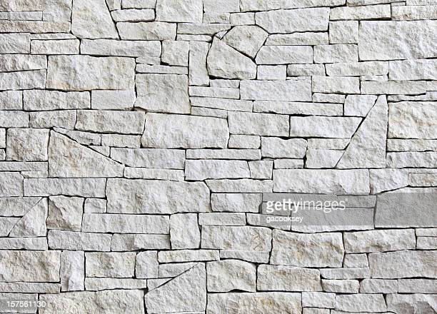 limestone wall - front view, many blocks - stone wall stock pictures, royalty-free photos & images