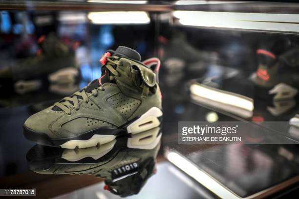 A limited edition of the Travis Scott x Air Jordan 6 sneaker is displayed in a shop as part of the 'raffles' on October 8 2019 in Paris