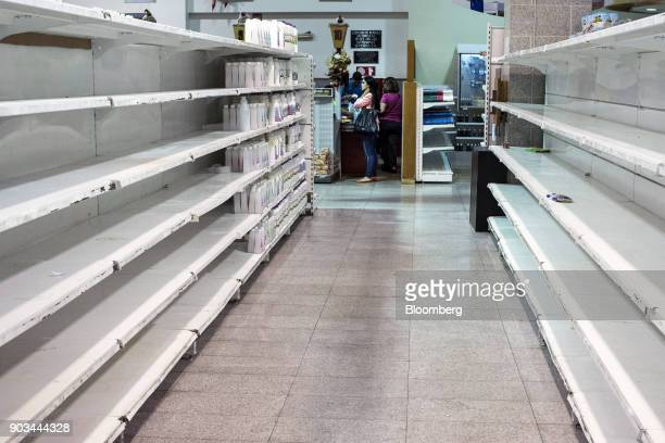 Limited supplies of beauty products sit on near empty shelves at a grocery store in Caracas Venezuela on Tuesday Jan 9 2018 Hordes of desperate...