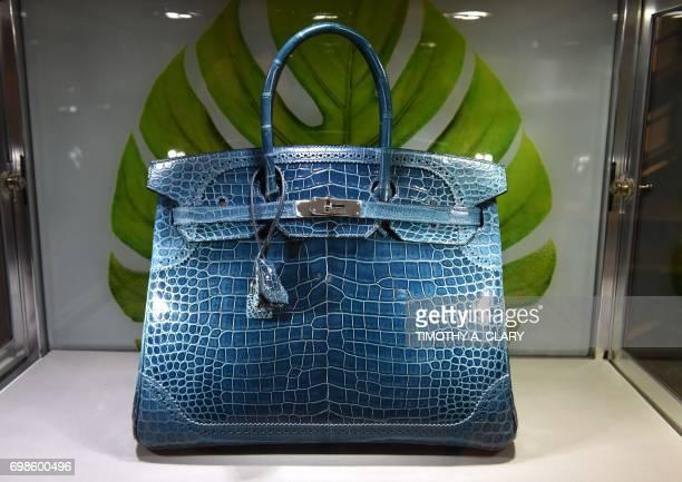 A limitededition Shiny Matte Bleu Colvert Porosus crocodile Ghillies Birkin 35 with palladium hardware Hermes 2015 is displayed at Christie's in New...