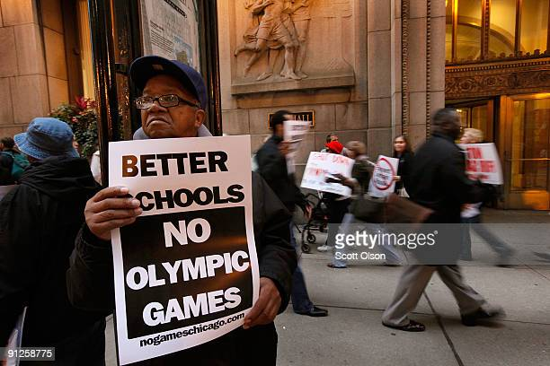 Limmie McMiller joins other demonstrators outside City Hall protesting against Chicago's bid to get the 2016 Olympics September 29 2009 in Chicago...