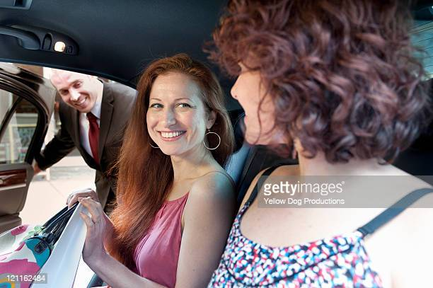 limo driver opening door for women - vehicle door stock pictures, royalty-free photos & images