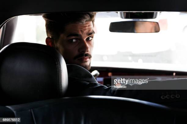 limo driver - taxi driver stock photos and pictures