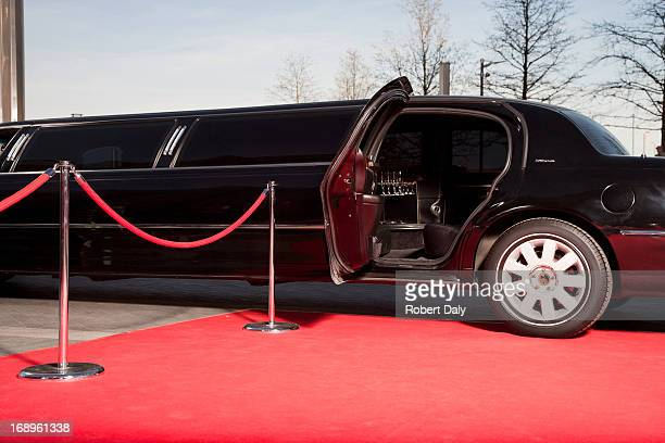 limo with open door on red carpet - beroemdheden stockfoto's en -beelden