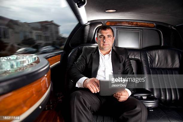limosine: business man with tablet computer - limousine stock pictures, royalty-free photos & images