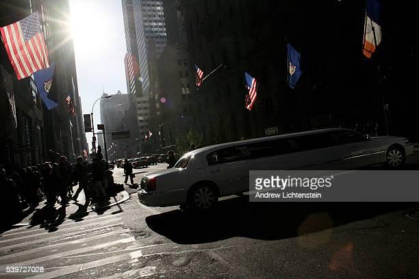 A limosine travels down Fifth Avenue November 28 New York City
