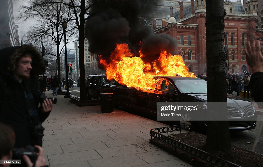 A limousine burns after being destroyed by anti-Trump protesters on K Street on January 20, 2017 in Washington, DC. While protests were mostly peaceful, some turned violent. President-elect Donald Trump was sworn-in as the 45th U.S. President today.