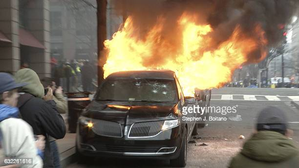A limousine burns in downtown Washington following the inauguration of President Donald Trump on January 20 2017 in Washington DC Washington and the...
