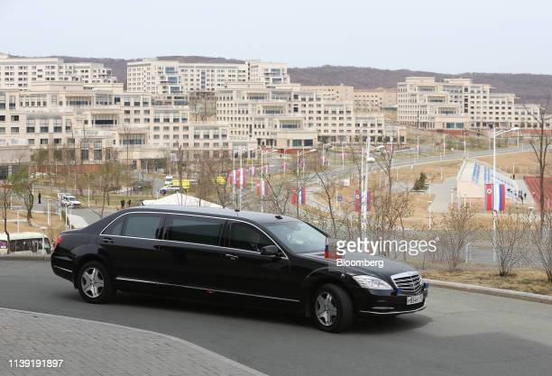 A limousine carrying Russia's President Vladimir Putin arrives ahead of his summit with North Korea's leader Kim Jong Un on Russky Island near...