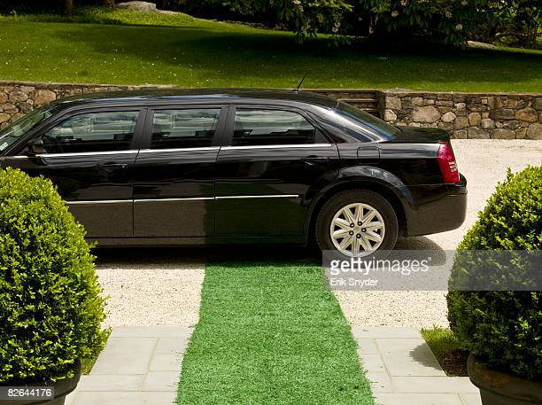 Limousine in front of estate home.