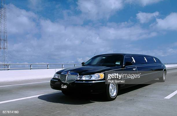 limousine on a highway - limousine stock pictures, royalty-free photos & images