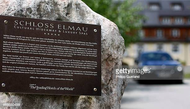 Limousine passes a sign at Schloss Elmau, a luxury spa hotel, in the Bavarian Alps of southern Germany on June 3, 2014 in Kruen near...