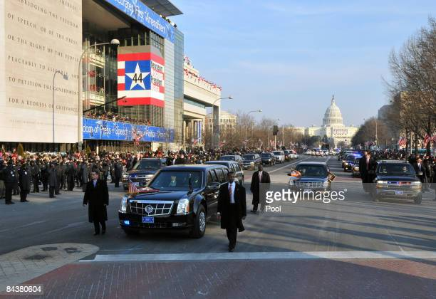 A limousine surrounded by four Secret Service agents carries President Barack Obama during the Inaugural Parade down Pennsylvania Avenue January 20...
