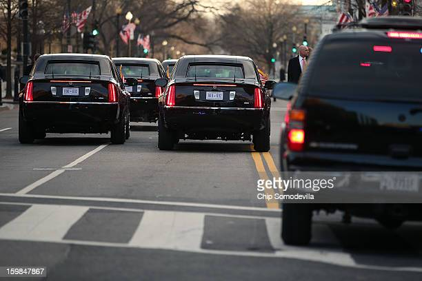Limousines drive in the presidential inaugural parade through the nation's capital January 21 2013 in Washington DC Barack Obama was reelected for a...