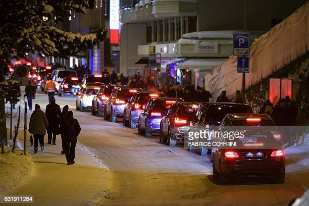 Limousines queue in the Promenade street in Davos on the opening day of the World Economic Forum on January 17 2017 in Davos The global elite begin a...