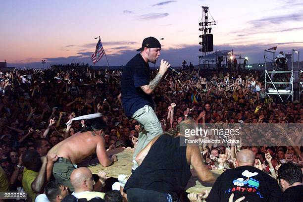 Limp Bizkit's Fred Durst brings his performance to the heads of the crowd of the east stage Saturday at Woodstock '99 in Rome New York Limp Bizkit...