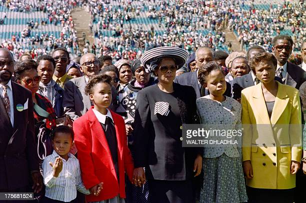 Limpho Hani wife of the assassinated South African Communist Party leader Chris Hani stands with her children during a vigil for her husband in...
