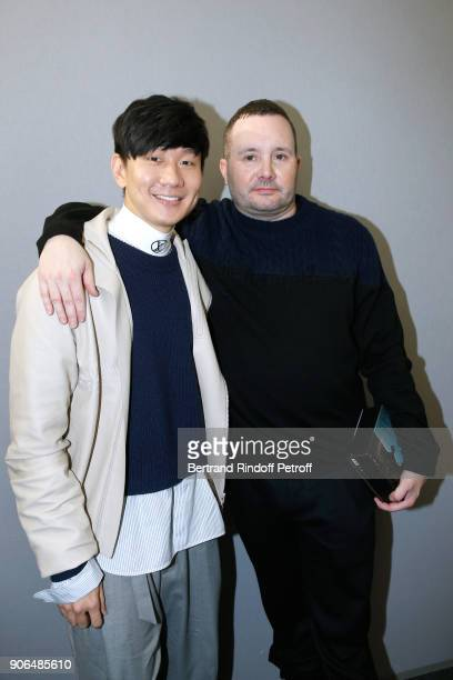 JJ Lin and Stylist Kim Jones pose after the Louis Vuitton Menswear Fall/Winter 20182019 show as part of Paris Fashion Week on January 18 2018 in...