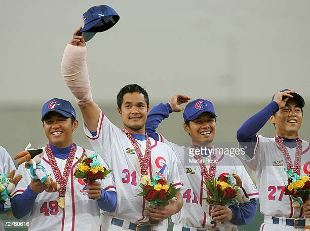 Lin Chih Sheng of Chinese Taipei waves to the crowd after receiving his Gold Medal in the Baseball Competition during the 15th Asian Games Doha 2006...