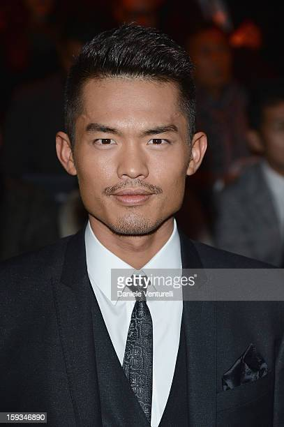 Lin Dan attends the Dolce Gabbana show as part of Milan Fashion Week Menswear Autumn/Winter 2013 on January 12 2013 in Milan Italy