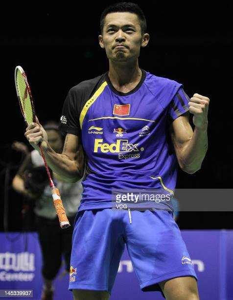 Lin Dan of China celebrates after defeating Hyun Il Lee of South Korea in the final match during the Thomas Cup world badminton team championships at...