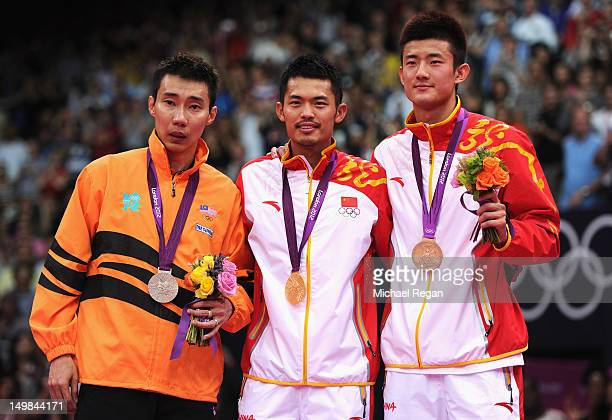 Lin Dan of China celebrates with his Gold medal on the podium Chong Wei Lee of Malaysia the Silver and Long Chen of China the Bronze following the...
