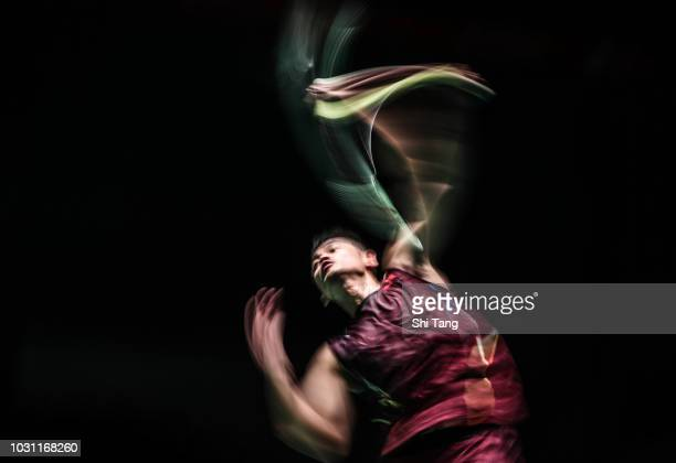 Lin Dan of China competes in the Men's Singles first round match against Kantaphon Wangcharoen of Thailand on day one of the Yonex Japan Open at...