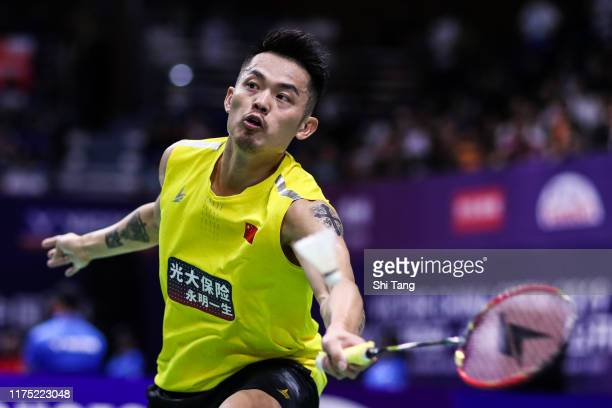 Lin Dan of China competes in the Men's Singles first round match against Kento Momota of Japan on day one of the China Open at Olympic Sports Center...