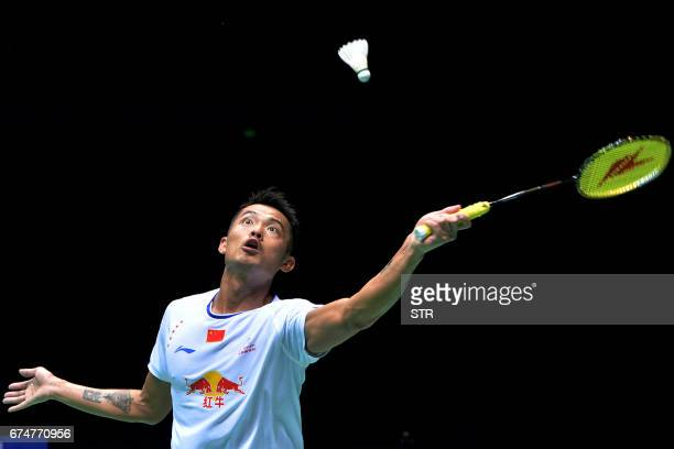 TOPSHOT Lin Dan of China hits a return against Lee Chong Wei of Malaysia during their men's singles semifinal match at the 2017 Badminton Asia...