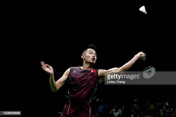 Lin Dan of China hits a shot against Sameer Verma of India in their Men's singles match during the Badminton World Championships at Nanjing Youth...
