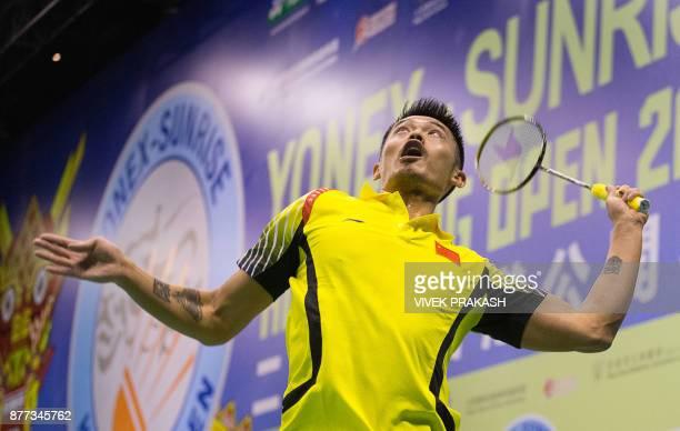Lin Dan of China hits a shot against Suppanyu Avihingsanon of Thailand during the Hong Kong Open badminton tournament in Hong Kong on November 22...