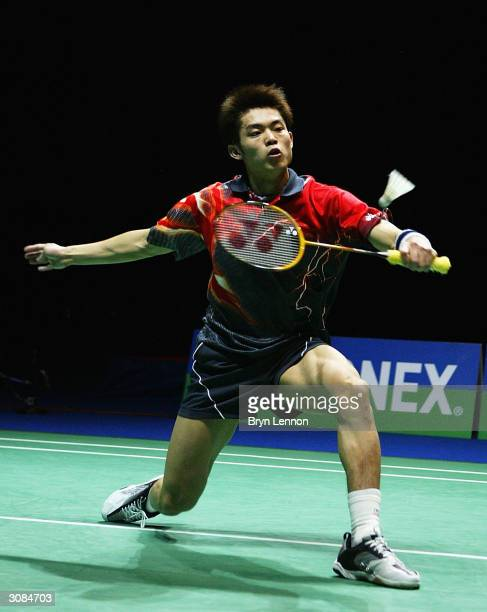 Lin Dan of China in action in the Men's Singles Final against Peter Gade of Denmark during the Finals of the Yonex All England Open Badminton...