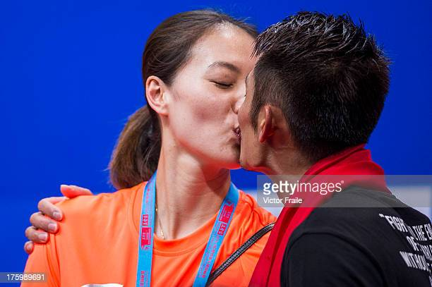 Lin Dan of China kisses his wife Xie Xingfang on the podium after winning the men's singles final match against Lee Chong Wei of Malaysia during the...