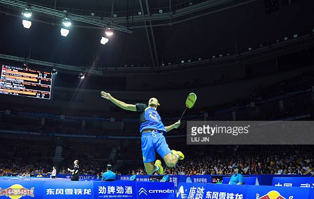 Lin Dan of China leaps to smash the shuttlecock against Rajiv Ouseph of England during their Group A match at the Thomas Cup world badminton team...