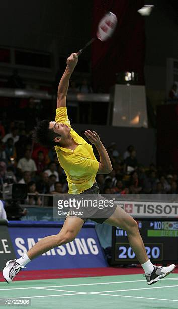 Lin Dan of China plays a smash during the Men's Badminton singles preliminary round during the 15th Asian Games Doha 2006 at The Aspire Hall,...